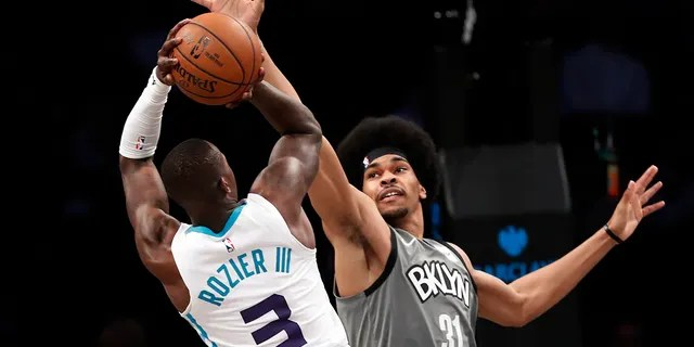 Brooklyn Nets center Jarrett Allen (31) defends against Charlotte Hornets guard Terry Rozier (3) during the second half of an NBA basketball game Wednesday, Nov. 20, 2019, in New York. The Nets won 101-91. (AP Photo/Kathy Willens)