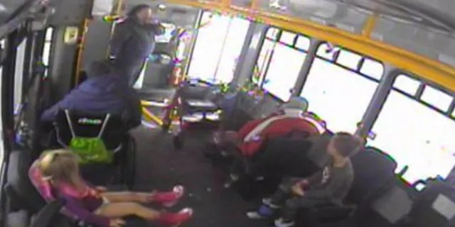 Nicole Chamberlain brought the two children on her bus after spotting them walking around in the cold on Monday.