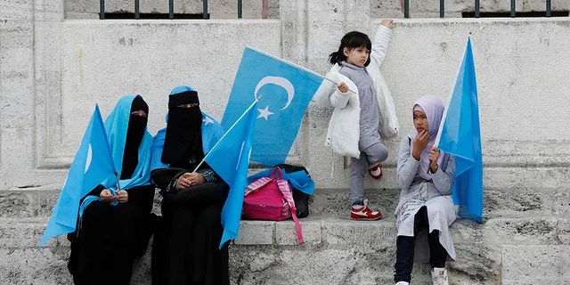 Uighur women hold East Turkestan flags at the courtyard of Fatih Mosque, a common meeting place for pro-Islamist demonstrators, during a protest against China, in Istanbul, Turkey, November 6, 2018.