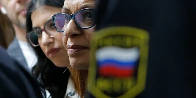 Israeli backpacker Naama Issachar's mother Yaffa Issachar, centre, and sister Liad Goldberg, left, wait to Issachar's appeal hearings in a courtroom in Moscow, Russia, Thursday, Dec. 19, 2019.