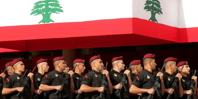 Lebanese marine special forces soldiers march during a military parade to mark the 76th anniversary of Lebanon's independence from France last month. (AP Photo/Hassan Ammar)