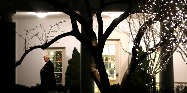 President Trump walking from the Oval Office as he headed to speak with reporters on the South Lawn of the White House before departing for the Pennsylvania rally Tuesday. (AP Photo/ Evan Vucci)