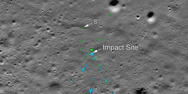 This image released by NASA shows the Vikram Lander impact point and the debris field. Green dots indicate spacecraft debris (confirmed or likely). Blue dots locate disturbed soil, likely where small bits of the spacecraft churned up the Moon's surface.