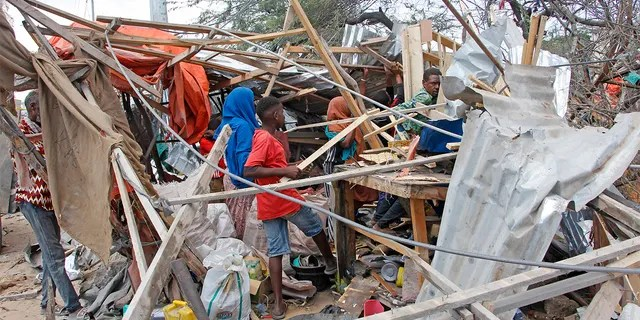 People salvaging goods after a car bomb destroyed shops in Mogadishu, Somalia, on Saturday. (AP Photo/Farah Abdi Warsame)