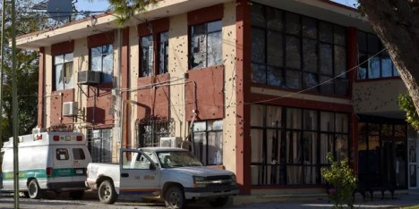 The City Hall of Villa Union is riddled with bullet holes after a gun battle between Mexican security forces and suspected cartel gunmen, Saturday, Nov. 30, 2019.