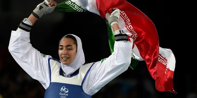 In this Aug. 18, 2016 file photo, Kimia Alizadeh Zenoorin of Iran celebrates after winning the bronze medal in a women's Taekwondo competition at the 2016 Summer Olympics in Rio de Janeiro, Brazil. (AP Photo/Andrew Medichini, File)