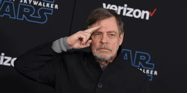 """Mark Hamill arrives at the world premiere of """"Star Wars: The Rise of Skywalker"""" in Los Angeles. Hamill praised workers at Bookmans Entertainment Exchange in Flagstaff, Ariz., for returning the """"Star Wars: A New Hope"""" soundtrack that had been a gift from film composer John Williams. (Jordan Strauss/Invision/AP, File)"""