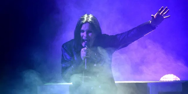 This Nov. 24, 2019 file photo shows Ozzy Osbourne performing at the American Music Awards in Los Angeles. The Grammy winner and former vocalist for the metal band Black Sabbath said during an interview on 'Good Morning America' that aired Tuesday, Jan. 21, 2020, that he's been diagnosed with Parkinson's disease, a nervous system disorder that affects movement. The diagnosis came after a fall the previous year.