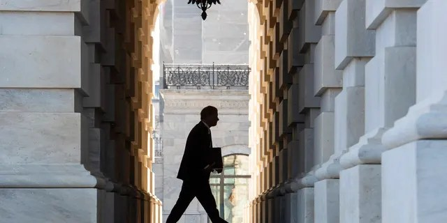 Supreme Court Chief Justice John Roberts arrives at the Capitol in Washington, Tuesday, Jan. 21, 2020. President Donald Trump'simpeachment trialquickly burst into a partisan fight Tuesday as proceedings began unfolding at the Capitol. Democrats objected strongly to rules proposed by the Republican leader for compressed arguments and a speedy trial. (AP Photo/Cliff Owen)