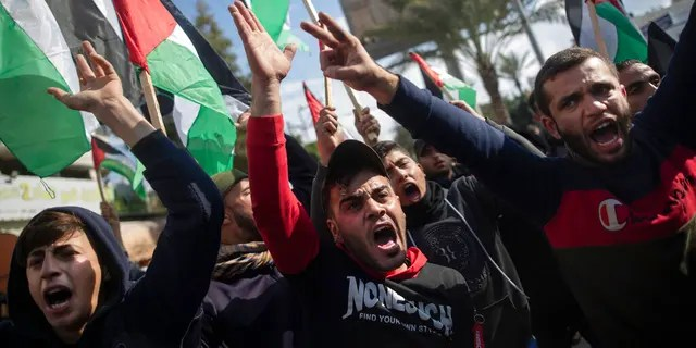 Palestinian protesters chant angry slogans during a protest against the U.S. Mideast peace plan, in Gaza City, Monday, Jan. 28, 2020.