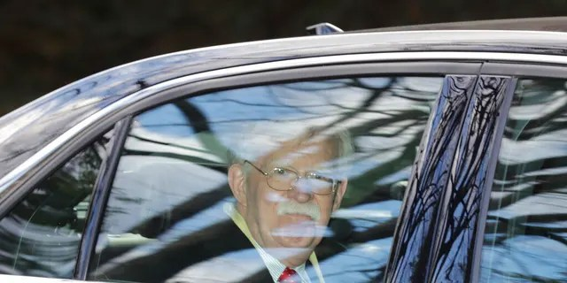 Former National security adviser John Bolton leaves his home in Bethesda, Md. Tuesday, Jan. 28, 2020. President Donald Trump's legal team is raising a broad-based attack on the impeachment case against him even as it mostly brushes past allegations in a new book that could undercut a key defense argument at the Senate trial. (Associated Press)