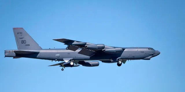 Bossier City, Louisiana, U.S.A.-April 6, 2017: A U.S. Air Force B 52 bomber, assigned to the Air Force Global Strike Command's Eighth Air Force, prepares to land at Barksdale Air Force Base.