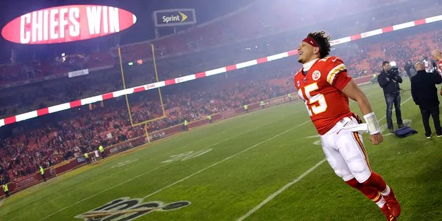Kansas City Chiefs quarterback Patrick Mahomes celebrates as he comes off the field after an NFL divisional playoff football game against the Houston Texans, Sunday in Kansas City, Mo. (AP Photo/Charlie Riedel)
