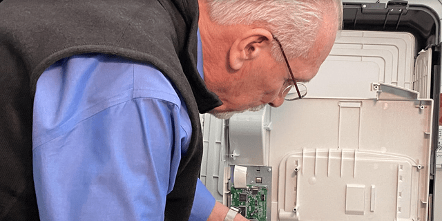 Richard Demillo takes apart voting machines and examines their security.