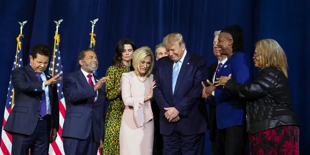 """Faith leaders pray over President Donald Trump during an """"Evangelicals for Trump Coalition Launch"""" at King Jesus International Ministry, Friday, Jan. 3, 2020, in Florida. (Associated Press)"""