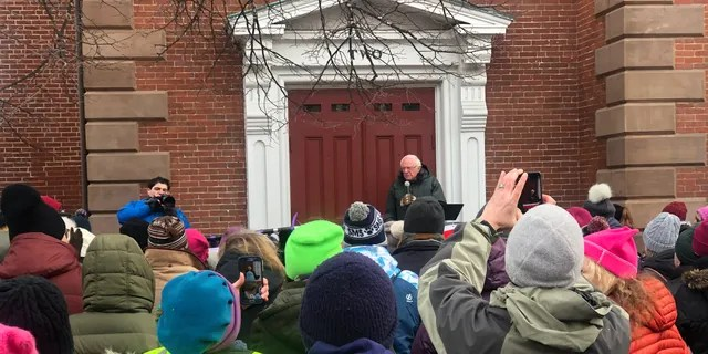 Democratic presidential candidate Sen. Bernie Sanders of Vermont speaks to the crowd ahead of a Portsmouth Women's March in Portsmouth, NH on Jan. 18, 2020