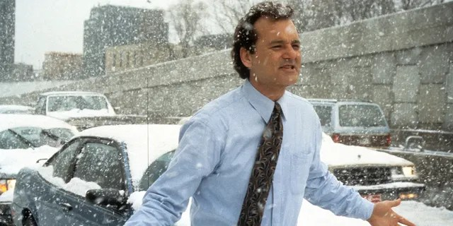 Actor Bill Murray runs through the snow in a scene from the film 'Groundhog Day', 1993. (Photo by Columbia Pictures/Getty Images)