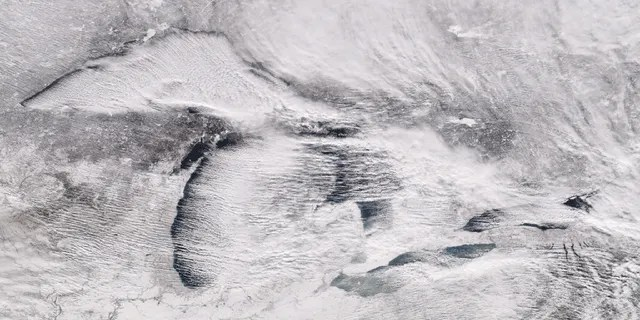 """Parallel rows of clouds, known as """"cloud streets"""" can be seen streaming over the Great Lakes on Christmas Day 2017 when up to 60 inches of snow fell on parts of Pennsylvania."""