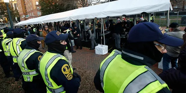 Virginia State troopers stand near a security checkpoint at the Capitol grounds in Richmond. (AP)