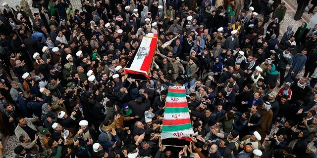 Mourners carry the coffins of Soleimani and Abu Mahdi al-Muhandis, deputy commander of Iran-backed militias, at the Imam Ali shrine in Najaf, Iraq, on Saturday. (AP Photo/Anmar Khalil)