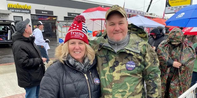 Trump supporter Laurie Reed of Plymouth, Mass., stands outside of the SNHU Arena in Manchester, NH, ahead of the president's re-election rally on the eve of the NH primary, on Feb. 10, 2020