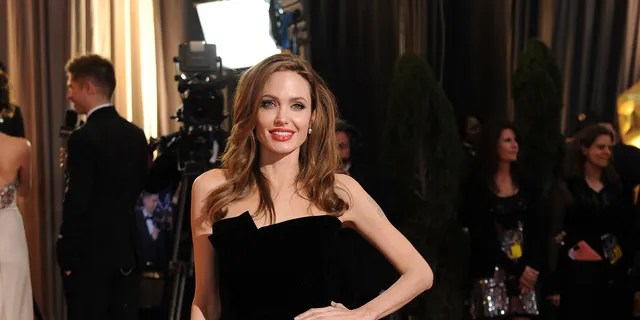 Angelina Jolie as she poses on the red carpet at the Hollywood & Highland Center Theatre during the 84th Academy Awards in Hollywood, California on Feb. 26, 2012.