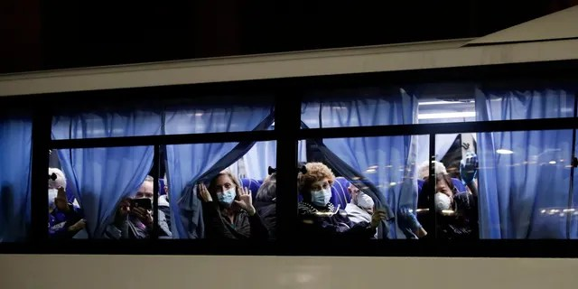 Buses carrying passengers from the quarantined Diamond Princess cruise ship leaving a port in Yokohama on Monday. (AP Photo/Jae C. Hong)