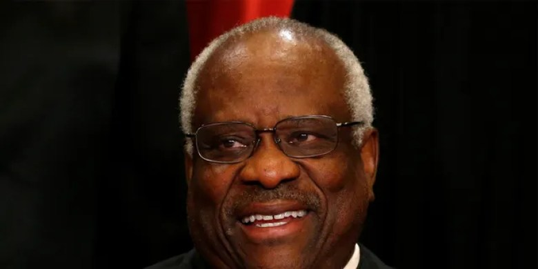 U.S. Supreme Court Justice Clarence Thomas participates in taking a new family photo with his fellow justices at the Supreme Court building in Washington, D.C., U.S., June 1, 2017. REUTERS/Jonathan Ernst - RC15CF6608B0