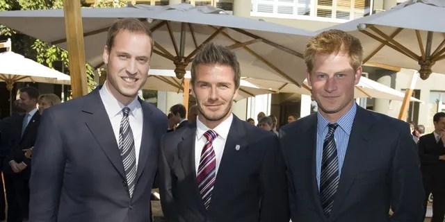 Prince William, David Beckham and Prince Harry in 2010. (Photo by Samir Hussein/Wireimage via Getty)