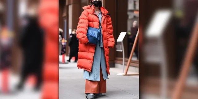 Marina Ingvarsson is seen wearing an orange puffer coat and blue bag outside the Michael Kors show during New York Fashion Week: A/W20 on February 12, 2020 in New York City. (Photo by Daniel Zuchnik/Getty Images)