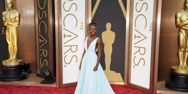 Lupita Nyong'o arrives at the 86th Annual Academy Awards at Hollywood & Highland Center on March 2, 2014 in Hollywood, California.