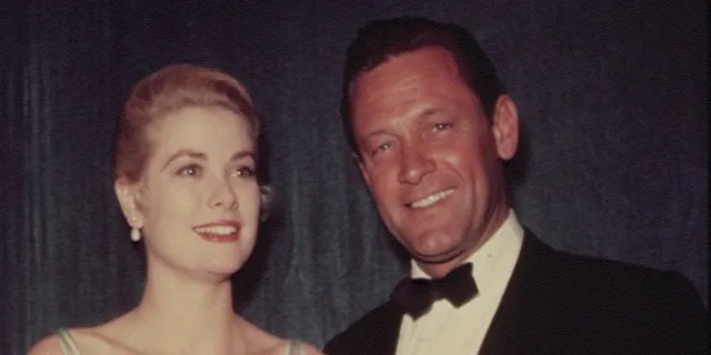 Grace Kelly and William Holden attend the 27th Academy Awards ceremony.