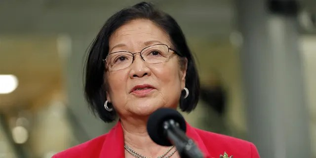 Sen. Mazie Hirono, D-Hawaii, speaks to reporters on Capitol Hill in Washington, Thursday, Jan. 30, 2020, during the impeachment trial of President Donald Trump on charges of abuse of power and obstruction of Congress. (AP Photo/Julio Cortez)