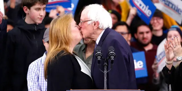 Democratic presidential candidate Sen. Bernie Sanders, I-Vt., kisses his wife Jane O'Meara Sanders, as he speaks to supporters at a primary night election rally in Manchester, N.H., Tuesday, Feb. 11, 2020. (AP Photo/Pablo Martinez Monsivais)