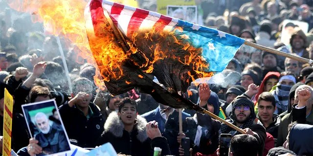 Iranian demonstrators burn a U.S. flag during a rally in Tehran on Tuesday celebrating the 41st anniversary of the Islamic Revolution.