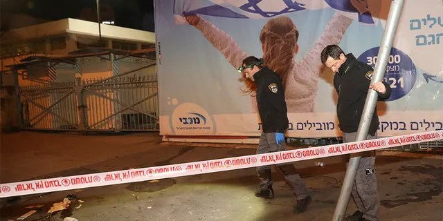 Israeli police officers inspect the scene of a ramming attack in Jerusalem on Thursday. (AP)