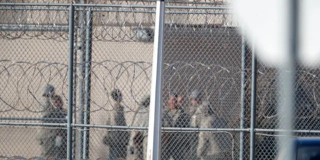 FILE: Prisoners stand outside of the federal correctional institution in Englewood, Colo.