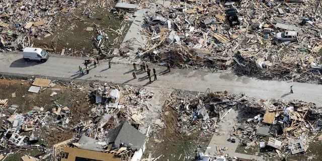 Emergency personnel work among destroyed homes Tuesday, March 3, 2020, near Cookeville, Tenn. AP Photo/Mark Humphrey