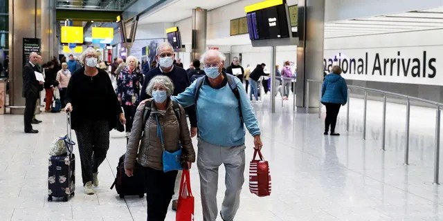Passengers from the coronavirus hit Braemar cruise ship return to Heathrow Airport in London, Thursday March 19, 2020.