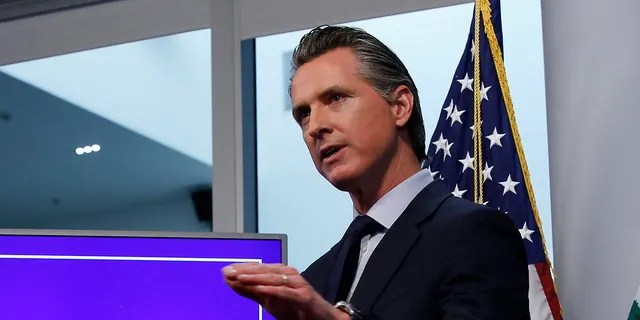 In this Tuesday April 14, 2020, file photo, California Gov. Gavin Newsom discusses an outline for what it will take to lift coronavirus restrictions, during a news conference at the Governor's Office of Emergency Services in Rancho Cordova, Calif. On Wednesday, April 22, Newson announced hospitals can resume scheduled surgeries. It's the first significant change to the state's stay-at-home order.