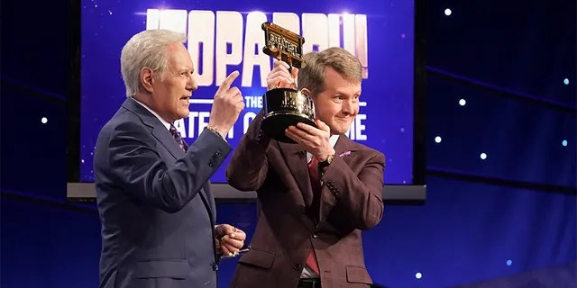Ken Jennings, right, took home the title of 'JEOPARDY! The Greatest of All Time.' (Eric McCandless/ABC via Getty Images)