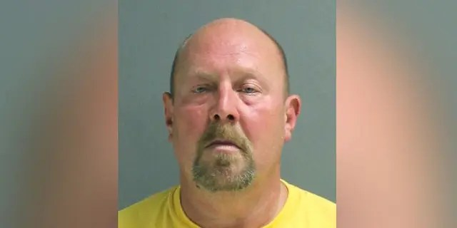 Christopher Canfora, 49, was arrested Tuesday after allegedly deliberately coughing on a cashier in the midst of the coronavirus public health crisis. (Volusia County Correctional Department)