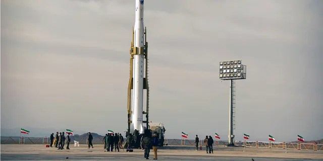 Iran's Revolutionary Guard said Wednesday it put the Islamic Republic's first military satellite into orbit, dramatically unveiling what experts described as a secret space program with a surprise launch that came amid wider tensions with the United States.