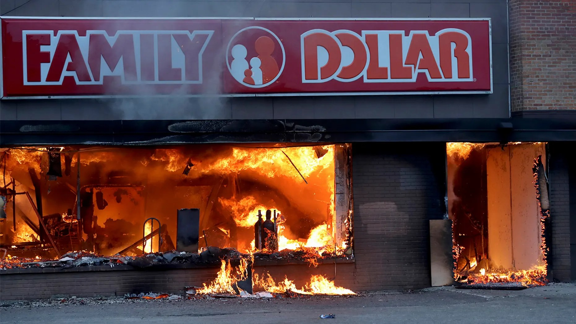 Fire burns inside The Family Dollar Store after a night of unrest and protests in the death of George Floyd early Friday, May 29, 2020 in Minneapolis. Floyd died after being restrained by Minneapolis police officers on Memorial Day. (David Joles/Star Tribune via AP)