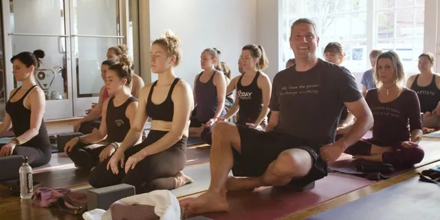 Rep. Tim Ryan taking a yoga class at a studio in Youngstown, Ohio. (photo courtesy of Rep. Ryan's office)