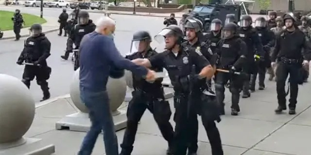 In this image from video provided by WBFO, a Buffalo police officer appears to shove a man who walked up to police Thursday, June 4, 2020, in Buffalo, N.Y. (Associated Press)