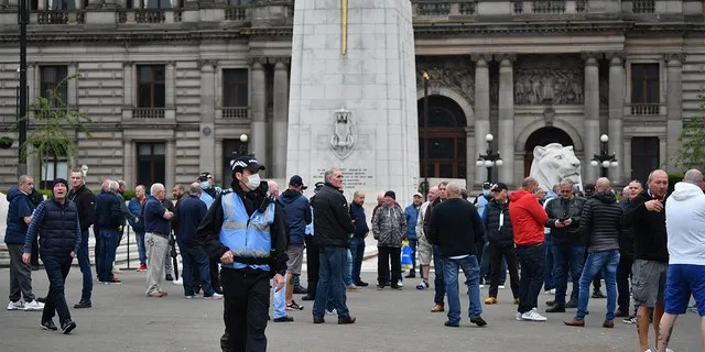 Activists gather at the George Square Cenotaph to protect him from vandalism on 13 June 2020 in Glasgow, Scotland. The Loyalist Defence League has asked its supporters to gather in George Square today for an event to