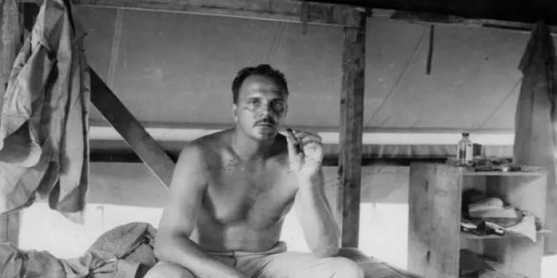 Frank Tachovsky resting on his bunk.