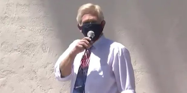 """Scottsdale City Council member Guy Phillips chanted """"I can't breathe!"""" before ripping off his face mask in front of a crowd of about 200 attending an """"Unmask Us"""" protest.<br data-recalc-dims="""