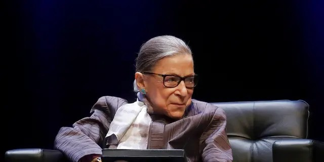 In this Oct. 21, 2019, file photo U.S. Supreme Court Justice Ruth Bader Ginsburg listens to speakers during the inaugural Herma Hill Kay Memorial Lecture at the University of California at Berkeley in Berkeley, Calif. (AP Photo/Jeff Chiu, File)